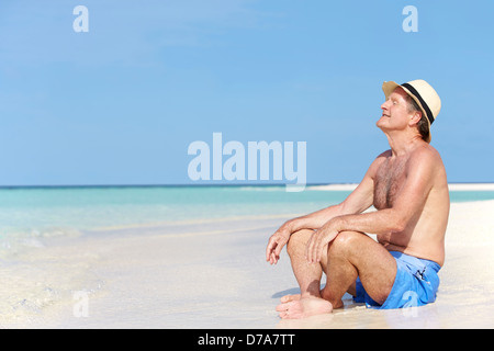 Senior Man Enjoying Beach Holiday - Stock Photo