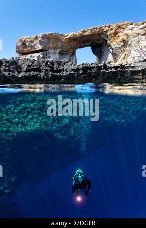 Scuba Diver at Azure Window, Gozo, Mediterranean Sea, Malta - Stock Photo