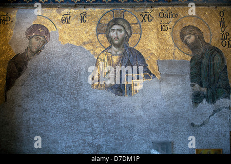 Virgin Mary, Jesus and John the Baptist, The Deesis Mosaic (12th centry) in The Hagia Sophia church, Istanbul, Turkey - Stock Photo