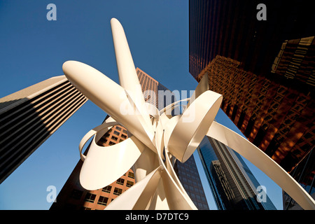 Worm's-eye view of Downtown Los Angeles skyscrapers and sculptur - Stock Photo
