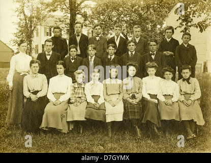 Circa 1900 school photo, showing a group of schoolboys and girls aged 10-14 years old. - Stock Photo