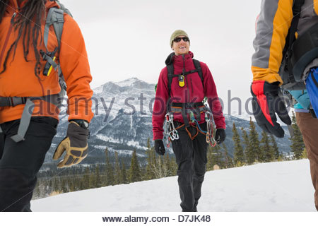 Man with group of friends on winter hike in mountains - Stock Photo