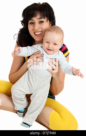 smiling mother and happy baby first steps - Stock Photo