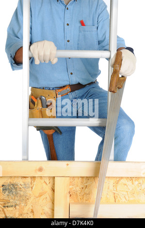 Closeup of a carpenter climbing a ladder isolated over white. The man wearing a work shirt, jeans, - Stock Photo