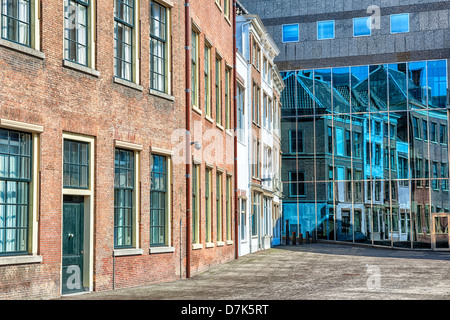 detail view of architecture in The Hague with reflections of old buildings in a new building - Stock Photo