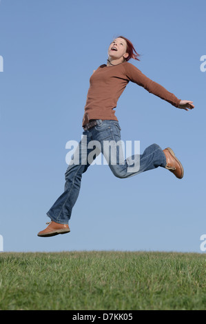 Woman making a happy jump - Stock Photo