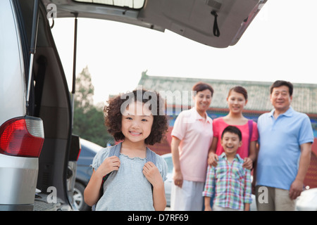 Portrait of girl with her family in the background - Stock Photo