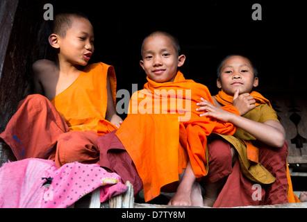 Three novice monks in village near Kengtung (Kyaingtong), Shan State, Burma - Stock Photo