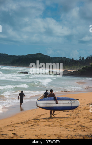 Surfer on Luquillo Beach, Puerto Rico, West Indies, Caribbean - Stock Photo