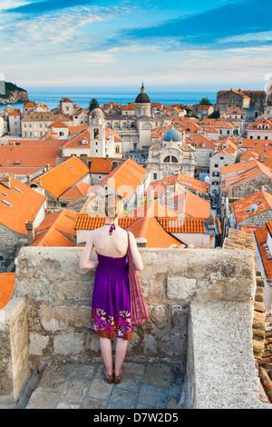 Tourist sightseeing on Dubrovnik City Walls, Old Town, UNESCO World Heritage Site, Dubrovnik, Dalmatian Coast, Croatia - Stock Photo