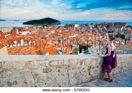 Tourist on Dubrovnik City Walls, Dubrovnik Old Town, UNESCO World Heritage Site, Dubrovnik, Dalmatian Coast, Adriatic, - Stock Photo