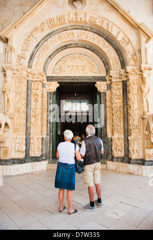 Tourists visiting the Cathedral of St. Lawrence, Trogir, UNESCO World Heritage Site, Dalmatian Coast, Croatia - Stock Photo