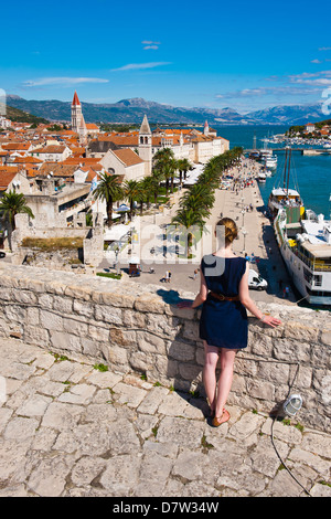 Tourist admiring the view from Kamerlengo Fortress over Trogir waterfront, Trogir, UNESCO World Heritage Site, Adriatic, - Stock Photo