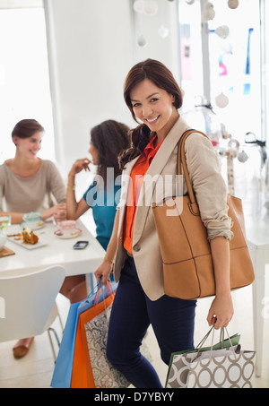 Woman shopping in store - Stock Photo