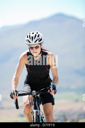 Cyclist on rural road - Stockfoto