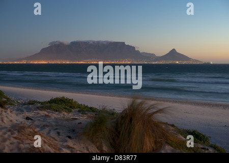 Table Mountain with kite surfers from Sunset Beach Cape own South Africa - Stock Photo