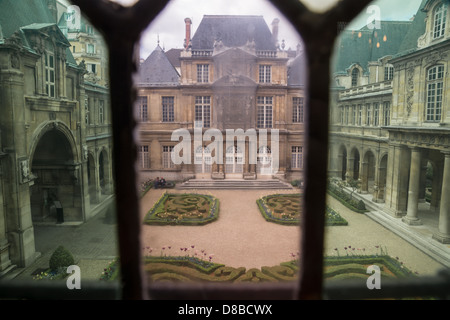 Paris, France. The Beautiful gardens of  Musee Carnavalet, the museum of the history of Paris, as seen through colored - Stock Photo