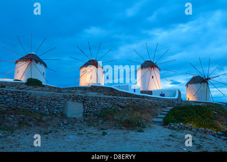 The famous Windmills of Mykonos island in Greece by night - Stock Photo
