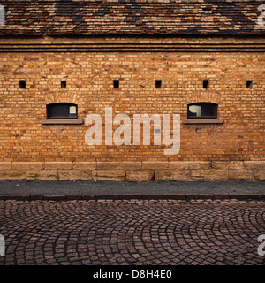 Detail of a brick wall with windows - Stock Photo