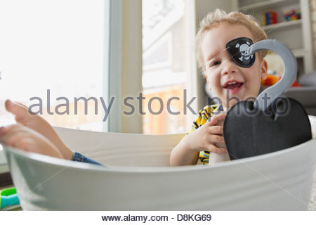 Portrait of little boy dressed as pirate - Stock Photo