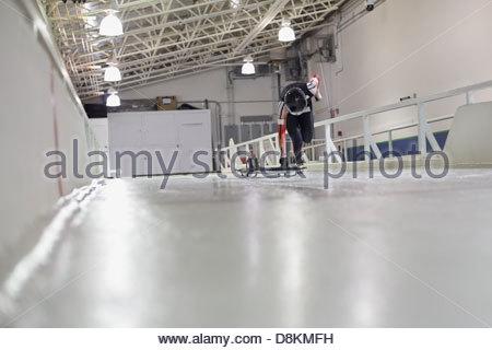 Female skeleton athlete practicing on track - Stock Photo