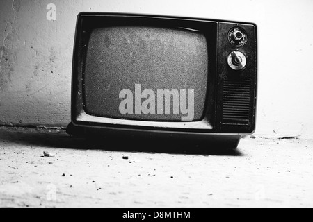 Old TV in room. Black and white film style colors. - Stockfoto