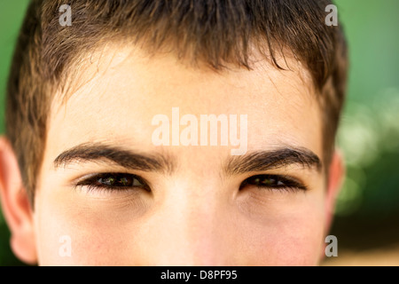 Young people and emotions, portrait of serious kid looking at camera. Closeup of eyes - Stockfoto