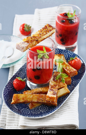 French toast and summer fruit soup with fresh mint - Stock Photo