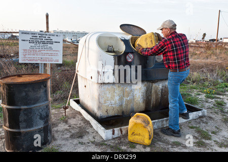 Man Recycling Used Motor Oil At Auto Parts Store Usa