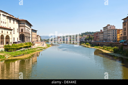 View of the river Arno taken from the famous Ponte Vecchio bridge in Florence, Italy - Stock Photo