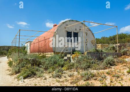 Abandoned red corrugated iron hut - Stock Photo