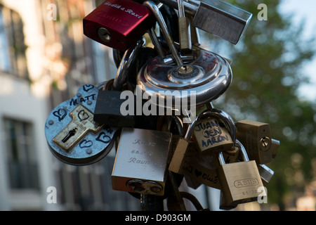 Netherlands, Amsterdam, Bicycle locks abandoned - Stock Photo