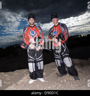 Men playing paintball, Sweden. - Stock Photo