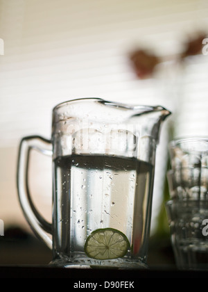 Ajug with water and glasses, Sweden. - Stock Photo