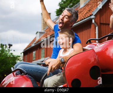 Father and child in an amusement parc. Grona Lund, Stockholm, Sweden. - Stock Photo