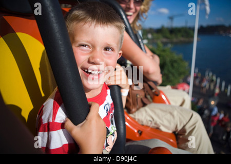A boy in an amusement parc. Grona Lund, Stockholm, Sweden. - Stock Photo
