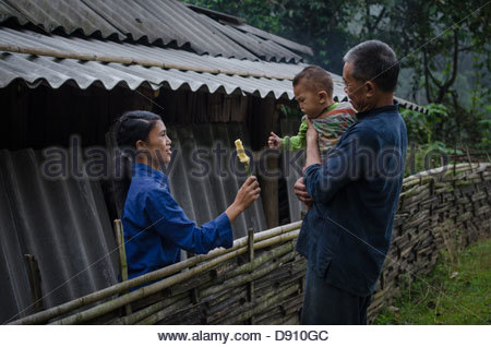 Vinh Quang Town, Ha Giang Province, Vietnam - SEP 10, 2011: An indigenous family, Mother's gift #1 - Stock Photo