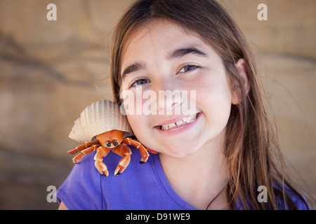 Young Pretty Girl Playing with Toy Hermit Crab. - Stock Photo