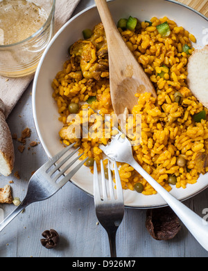 a pan with spanish rice paella style with forks - Stock Photo