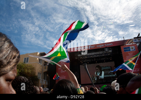 Football fan waves South African flag during live concert as part FIFA world cup final draw festivities on Long - Stockfoto