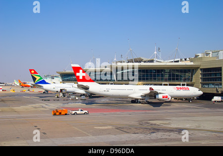 JOHANNESBURG - APRIL 18:Airbus A340 disembarking passengers after intercontinental flights on April 18, 2012 in - Stock Photo