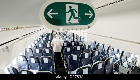 An emergency exit sign is visible within a Boening 787 'Dreamliner' of airline Thomson Airways during a lecture - Stock Photo
