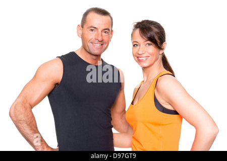 Sport couple in front of white background - Stock Photo