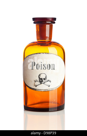 Bottle of poison with skull and crossbones warning sign on label - Stock Photo
