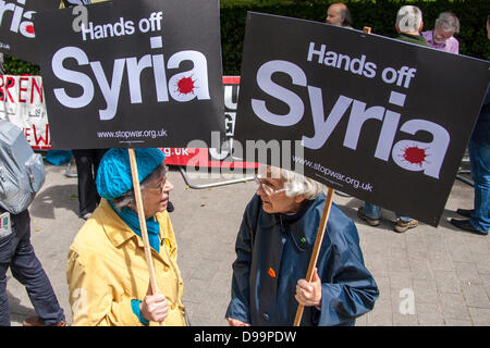 London, UK.15th June 2013. Protesters say 'Hands off Syria' as the likelihood of the US and the UK assisting rebels - Stock Photo