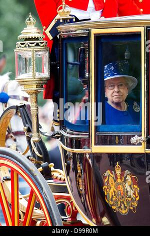 London, UK. 15th June 2013. Queen Elizabeth attends trooping the colour parade in London, United Kingdom,15 June - Stock Photo