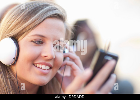 Young woman wearing headphones - Stock Photo