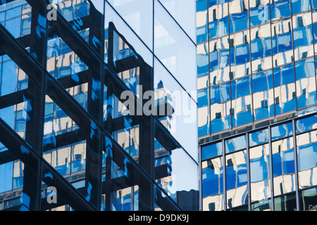 Close up of skyscrapers with glass facades - Stock Photo
