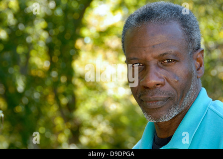 Happy mature man looking relaxed in garden - Stock Photo