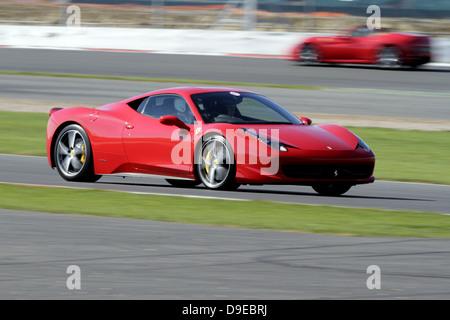 2011 ferrari 458 italia red italian supercar steering wheel and stock photo royalty free image. Black Bedroom Furniture Sets. Home Design Ideas